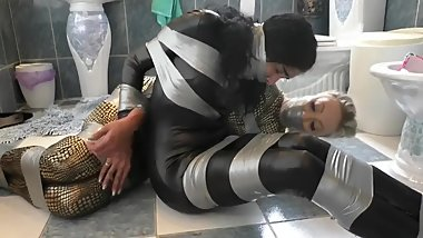two catsuit agents captured tied up and gaged tightly