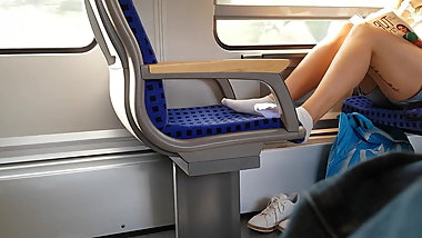 White sneaker socks feet in train