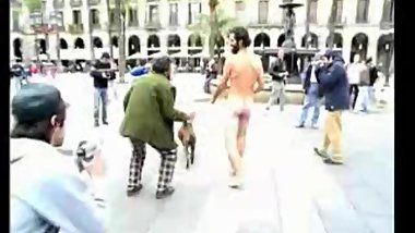 Walking a dog, naked in streets of Barcelona