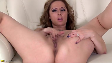 Busty natural MILF fingering her wet pussy