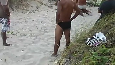 Naughty giving to various males on a beach
