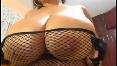 Latina BBW plays with her massive rack on webcam..